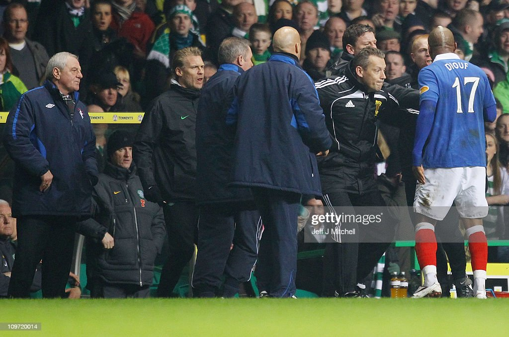 <a gi-track='captionPersonalityLinkClicked' href=/galleries/search?phrase=Neil+Lennon&family=editorial&specificpeople=642944 ng-click='$event.stopPropagation()'>Neil Lennon</a> coach of Celtic reacts with El Hadji Diouf #17 of Rangers during the Scottish Cup fifth round match between Celtic and Rangers at Celtic Park on March 2, 2011 in Glasgow, Scotland.