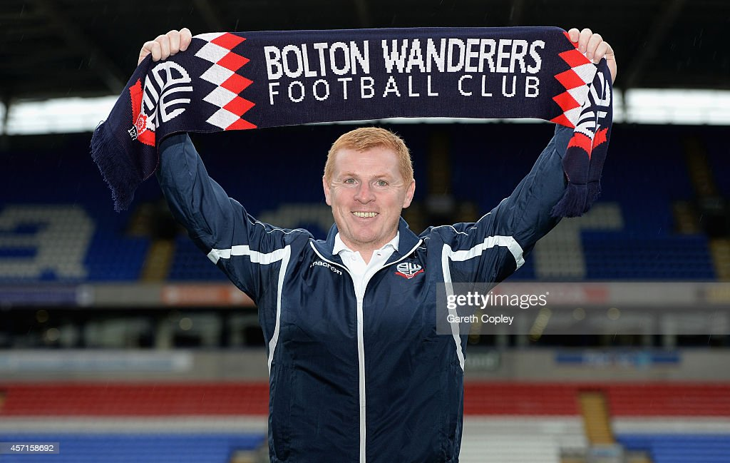 Neil Lennon poses for a photographers after a press conference where he was unveiled as the new Bolton Wanderers manager at the Macron Stadium on...