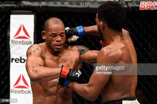 Neil Magny of the United States punches Hector Lombard of Cuba in their welterweight bout during the UFC Fight Night event at the Brisbane...