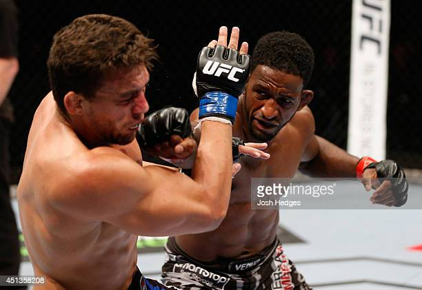Neil Magny punches Rodrigo de Lima in their welterweight fight during the UFC Fight Night event at Vector Arena on June 28 2014 in Auckland New...