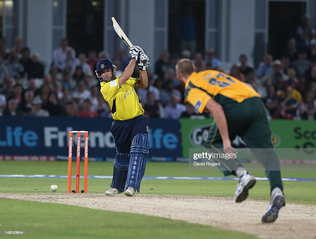 <a gi-track='captionPersonalityLinkClicked' href=/galleries/search?phrase=Neil+McKenzie+-+Cricket+Player&family=editorial&specificpeople=2224176 ng-click='$event.stopPropagation()'>Neil McKenzie</a> of Hampshire drives the ball for four runs during the Friends Life T20 match between Nottinghamshire and Hampshire at Trent Bridge on July 25, 2012 in Nottingham, England.