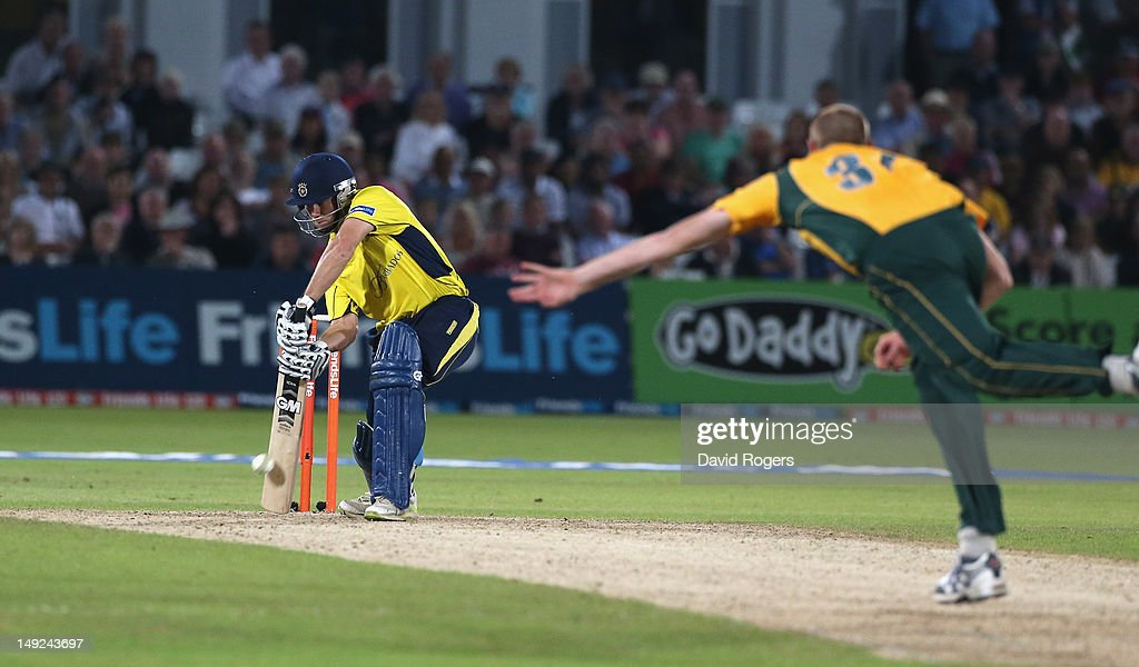 <a gi-track='captionPersonalityLinkClicked' href=/galleries/search?phrase=Neil+McKenzie+-+Cricket+Player&family=editorial&specificpeople=2224176 ng-click='$event.stopPropagation()'>Neil McKenzie</a> of Hampshire scores the match winning run off the final ball during the Friends Life T20 match between Nottinghamshire and Hampshire at Trent Bridge on July 25, 2012 in Nottingham, England.