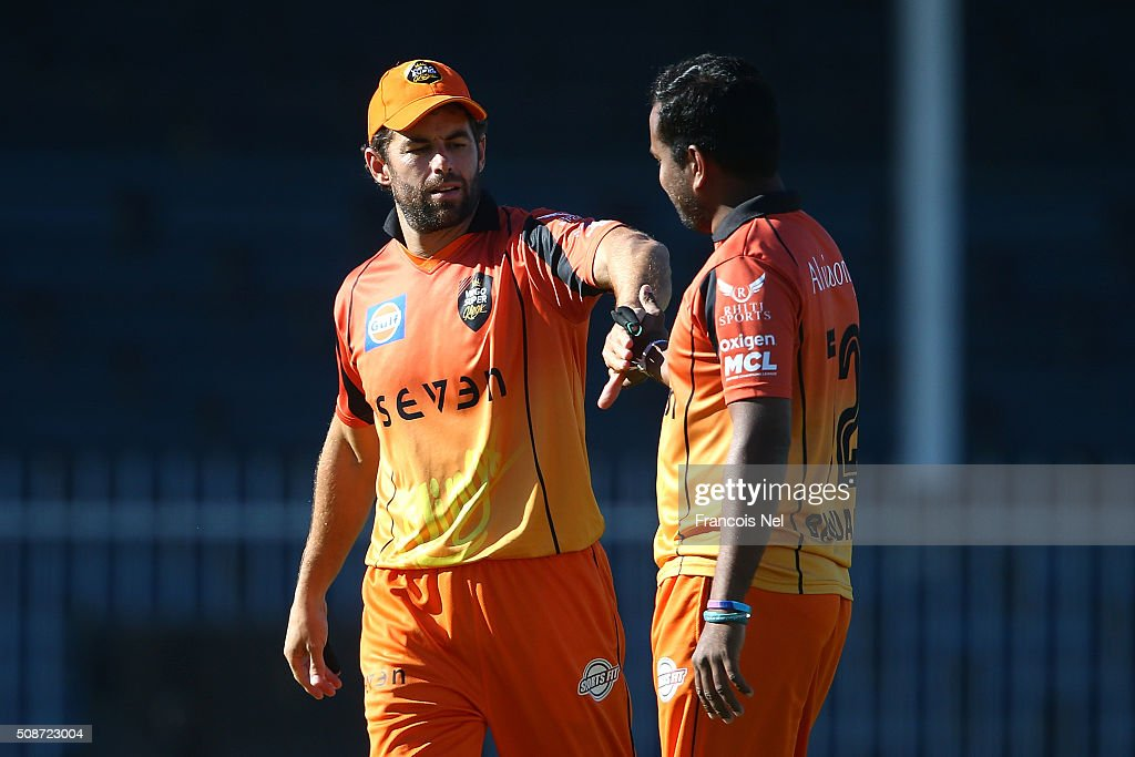 Neil McKenzie of Virgo congratulates Malinga Bandara after he took the wicket of Jacques Rudolph during the Oxigen Masters Champions League match between Gemini Arabians and Virgo Super Kings on February 6, 2016 in Sharjah, United Arab Emirates.