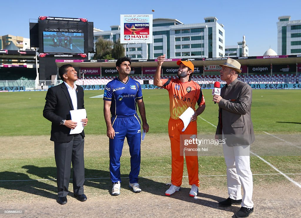 Neil McKenzie the Captain of Virgo Super Kings performs the coin toss as <a gi-track='captionPersonalityLinkClicked' href=/galleries/search?phrase=Abdul+Razzaq&family=editorial&specificpeople=176467 ng-click='$event.stopPropagation()'>Abdul Razzaq</a> the Captain of Capricorn Commanders looks on prior to the Oxigen Masters Champions League match between Virgo Super Kings and Capricorn Commanders on February 7, 2016 in Sharjah, United Arab Emirates.
