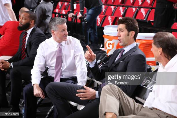 Neil Olshey of the Portland Trail Blazers and Bob Myers of the Golden State Warriors attend Game Three of the Western Conference Quarterfinals of the...