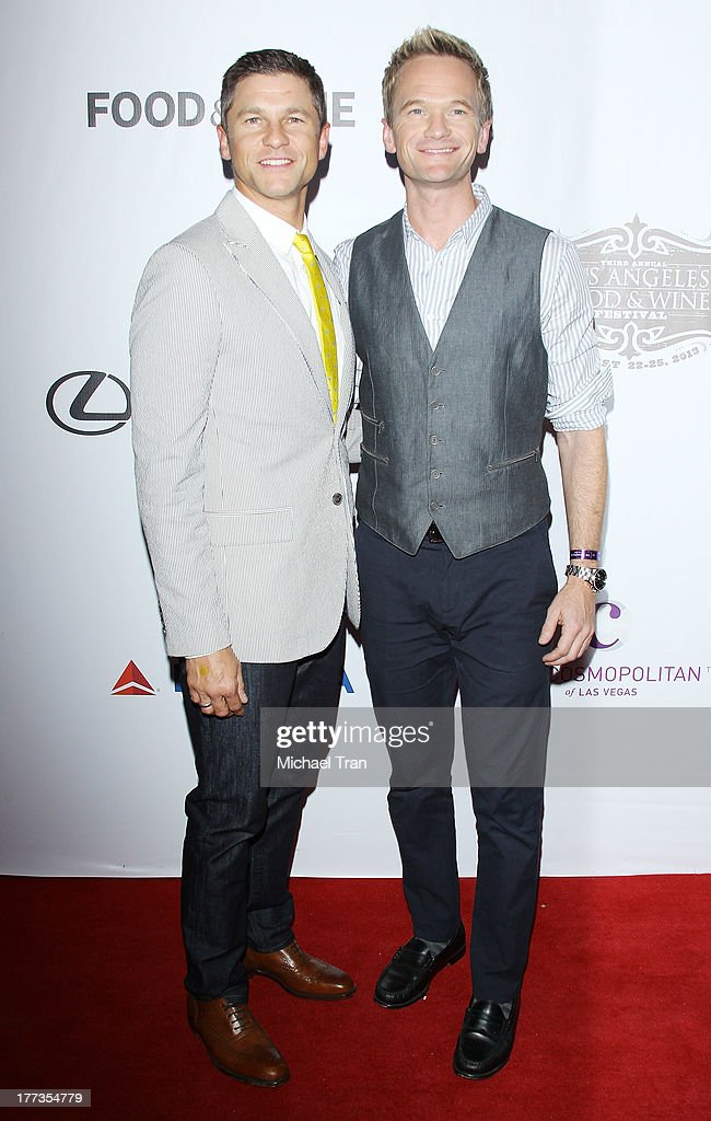<a gi-track='captionPersonalityLinkClicked' href=/galleries/search?phrase=Neil+Patrick+Harris&family=editorial&specificpeople=210509 ng-click='$event.stopPropagation()'>Neil Patrick Harris</a> (R) and <a gi-track='captionPersonalityLinkClicked' href=/galleries/search?phrase=David+Burtka&family=editorial&specificpeople=572242 ng-click='$event.stopPropagation()'>David Burtka</a> arrives at the 2013 Los Angeles Food & Wine Festival - 'Festa Italiana With Giada De Laurentiis' opening night held on August 22, 2013 in Los Angeles, California.