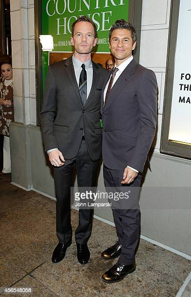 Neil Patrick Harris and David Burtka attend 'The Country House' Opening Night Arrivals Curtain Call at Samuel J Friedman Theatre on October 2 2014 in...