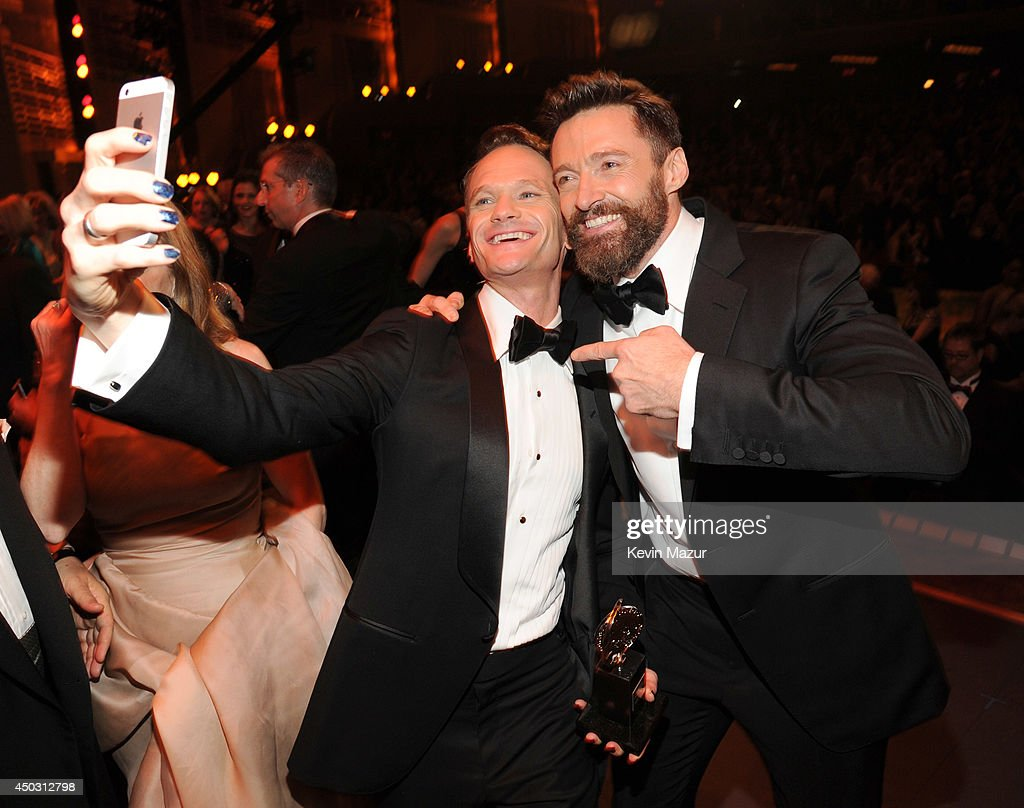 <a gi-track='captionPersonalityLinkClicked' href=/galleries/search?phrase=Neil+Patrick+Harris&family=editorial&specificpeople=210509 ng-click='$event.stopPropagation()'>Neil Patrick Harris</a> and <a gi-track='captionPersonalityLinkClicked' href=/galleries/search?phrase=Hugh+Jackman&family=editorial&specificpeople=202499 ng-click='$event.stopPropagation()'>Hugh Jackman</a> attend the 68th Annual Tony Awards at Radio City Music Hall on June 8, 2014 in New York City.