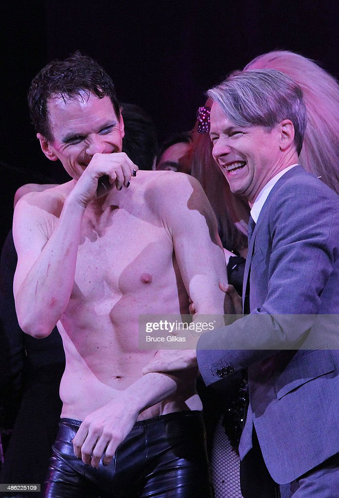<a gi-track='captionPersonalityLinkClicked' href=/galleries/search?phrase=Neil+Patrick+Harris&family=editorial&specificpeople=210509 ng-click='$event.stopPropagation()'>Neil Patrick Harris</a> and <a gi-track='captionPersonalityLinkClicked' href=/galleries/search?phrase=John+Cameron+Mitchell&family=editorial&specificpeople=207124 ng-click='$event.stopPropagation()'>John Cameron Mitchell</a> take the Broadway opening night curtain call for'Hedwig And The Angry Inch' at The Belasco Theatre on April 22, 2014 in New York City.