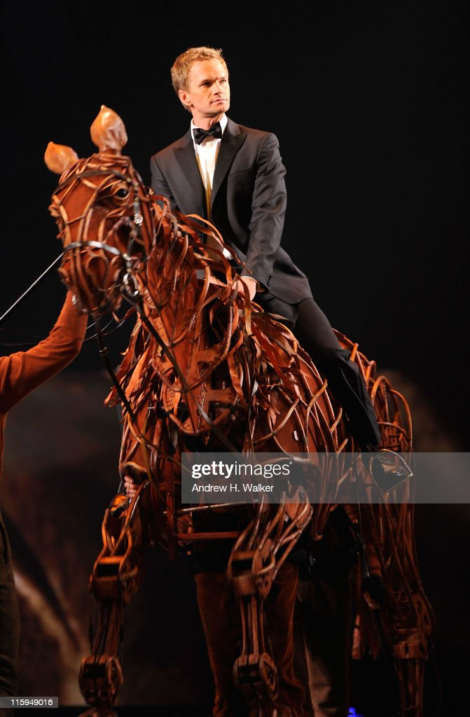 Neil Patrick Harris enters the stage on a puppet from 'War Horse' during the 65th Annual Tony Awards at the Beacon Theatre on June 12, 2011 in New York City.