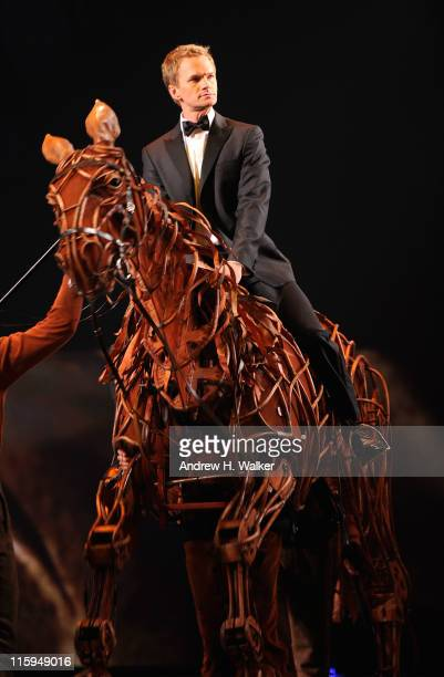 Neil Patrick Harris enters the stage on a puppet from 'War Horse' during the 65th Annual Tony Awards at the Beacon Theatre on June 12 2011 in New...