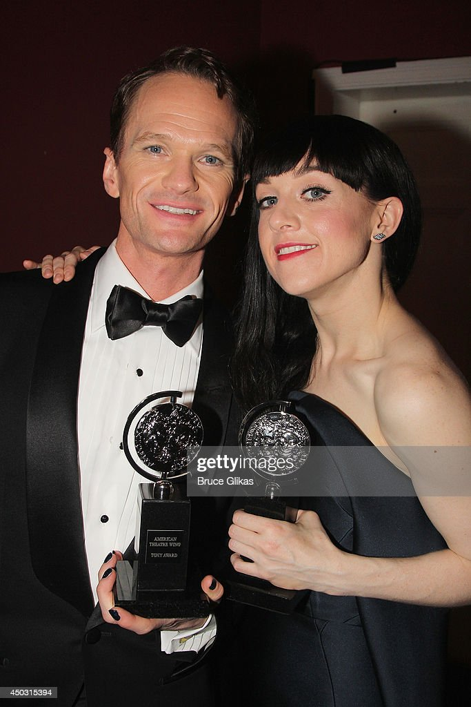 <a gi-track='captionPersonalityLinkClicked' href=/galleries/search?phrase=Neil+Patrick+Harris&family=editorial&specificpeople=210509 ng-click='$event.stopPropagation()'>Neil Patrick Harris</a>, winner of the award for Best Actor in a Musical for 'Hedwig And The Angry Inch' (L) and <a gi-track='captionPersonalityLinkClicked' href=/galleries/search?phrase=Lena+Hall&family=editorial&specificpeople=9446196 ng-click='$event.stopPropagation()'>Lena Hall</a>, winner of the award for Best Performance by an Actress in a Feature Role in a Musical for 'Hedwig and the Angry Inch' pose in the press room during the American Theatre Wing's 68th Annual Tony Awards at Radio City Music Hall on June 8, 2014 in New York City.