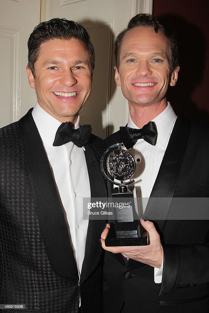 <a gi-track='captionPersonalityLinkClicked' href=/galleries/search?phrase=Neil+Patrick+Harris&family=editorial&specificpeople=210509 ng-click='$event.stopPropagation()'>Neil Patrick Harris</a>, winner of Tony Award For Best Actor In A Musical for 'Hedwig And The Angry Inch' (R) and <a gi-track='captionPersonalityLinkClicked' href=/galleries/search?phrase=David+Burtka&family=editorial&specificpeople=572242 ng-click='$event.stopPropagation()'>David Burtka</a> pose in the press room during the American Theatre Wing's 68th Annual Tony Awards at Radio City Music Hall on June 8, 2014 in New York City.