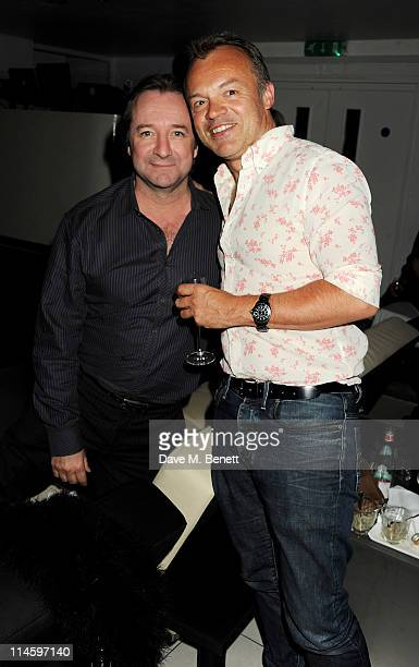 Neil Pearson and Graham Norton attend the launch of Le Crazy Horse cabaret show at Supperclub on May 24 2011 in London England