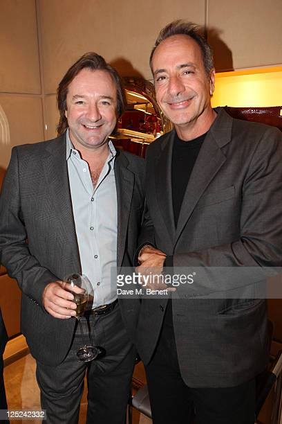 Neil Pearson and guest attend the 'Just A Drop' Charity Party hosted by Marie Helvin at the Roger Vivier Store on September 15 2011 in LondonEngland