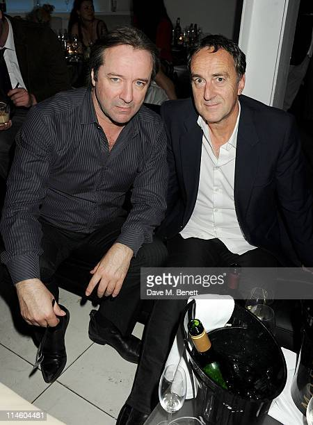 Neil Pearson and guest attend the launch of Le Crazy Horse cabaret show at Supperclub on May 24 2011 in London England