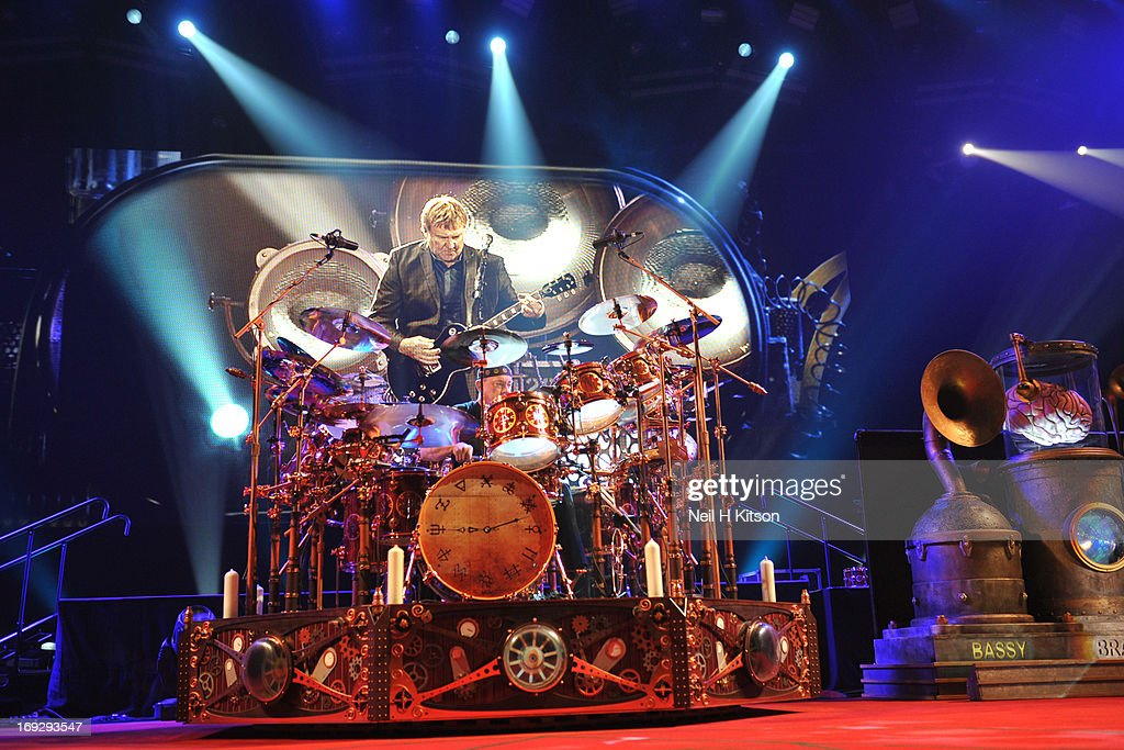 Neil Peart of Rush performs on stage at Manchester Arena on May 22, 2013 in Manchester, England.
