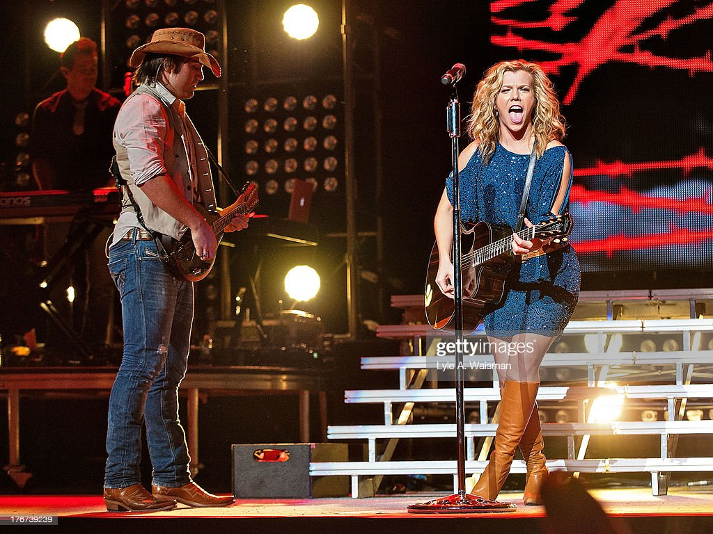 Neil Perry and <a gi-track='captionPersonalityLinkClicked' href=/galleries/search?phrase=Kimberly+Perry&family=editorial&specificpeople=6718325 ng-click='$event.stopPropagation()'>Kimberly Perry</a> of the American country music group The Band Perry perform at First Midwest Bank Amphitheatre on August 17, 2013 in Tinley Park, Illinois.