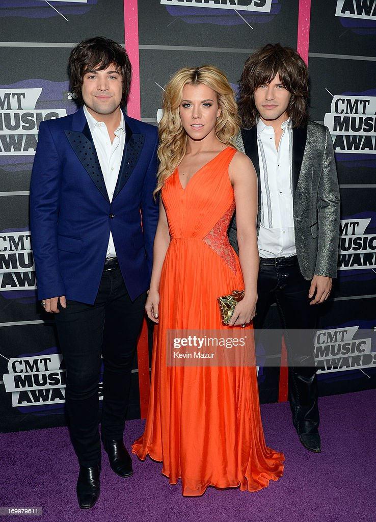 Neil Perry, Kimberly Perry and Reid Perry attend the 2013 CMT Music awards at the Bridgestone Arena on June 5, 2013 in Nashville, Tennessee.