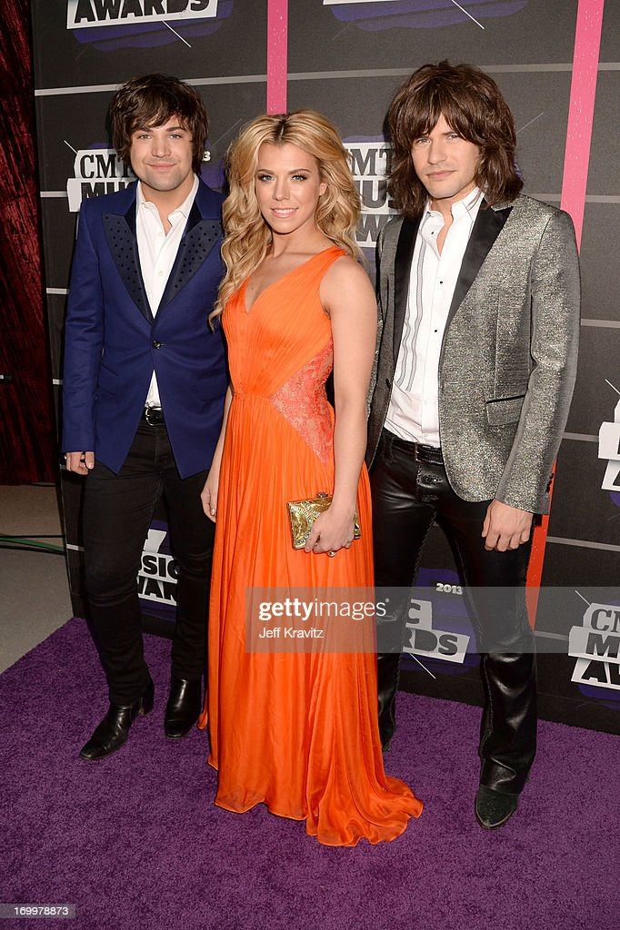Neil Perry, Kimberly Perry and Reid Perry of The Band Perry arrive at the 2013 CMT Music Awards at the Bridgestone Arena on June 5, 2013 in Nashville, Tennessee.