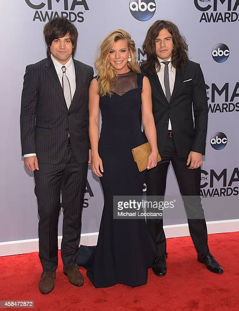 Neil Perry Kimberly Perry and Reid Perry of The Band Perry attend the 48th annual CMA Awards at the Bridgestone Arena on November 5 2014 in Nashville...