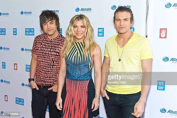 R Neil Perry Kimberly Perry and Reid Perry of The Band Perry attend We Day at Allstate Arena on April 30 2015 in Rosemont Illinois