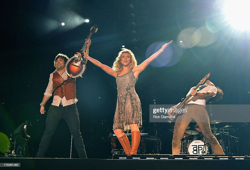 Neil Perry, Kimberly Perry and Reid Perry of The Band Perry perform during the 2013 CMA Music Festival on June 9, 2013 in Nashville, Tennessee.