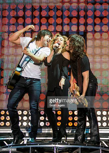 Neil Perry Kimberly Perry and Reid Perry of The Band Perry performs during the 2014 WYCD Downtown Hoedown at Comerica Park on June 1 2014 in Detroit...