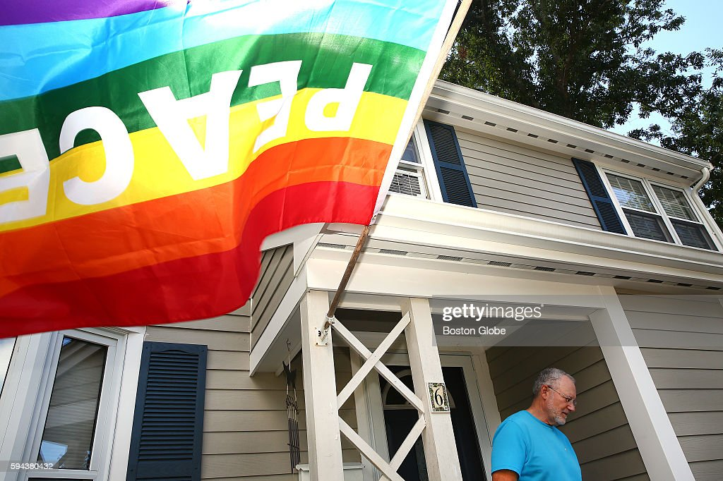 Neil Podolski and his girlfriend not pictured have a rainbow flag on the front of their home in Natick Mass in support of their neighbors Married...