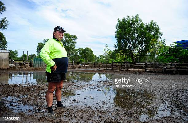 Neil Proefke surveys his backyard after flood waters fall on January 16 2011 in Rockhampton Australia Rockampton experienced some of Queensland's...