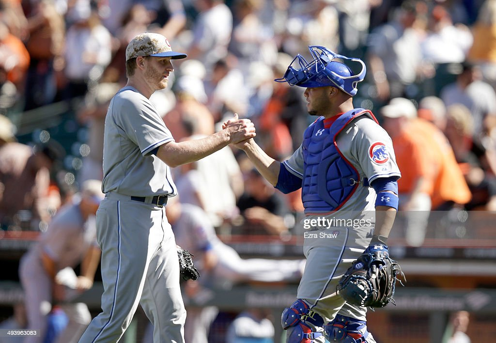 Neil Ramirez #54 of the Chicago Cubs and Welington Castillo #5 congratulate one another after they beat the San Francisco Giants at AT&T Park on May 26, 2014 in San Francisco, California.