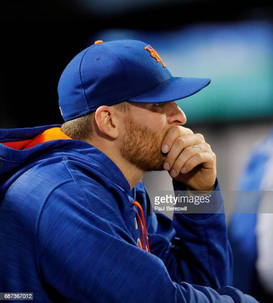 Neil Ramirez of the New York Mets reacts in the dugout after being pulled from the game in the 9th inning of an interleague MLB baseball game against...