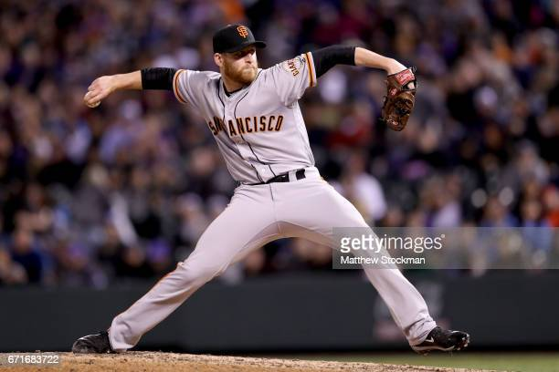 Neil Ramirez of the San Francisco Giants throws in the eighth inning against the Colorado Rockies at Coors Field on April 22 2017 in Denver Colorado
