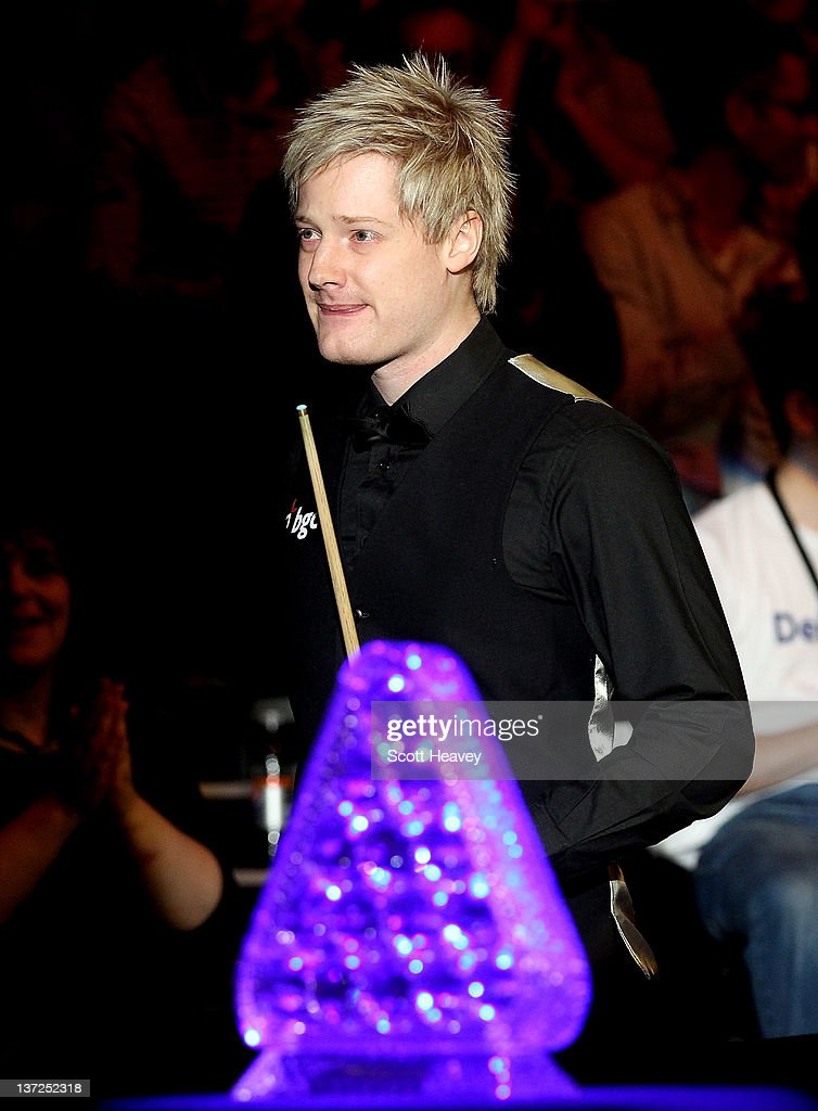<a gi-track='captionPersonalityLinkClicked' href=/galleries/search?phrase=Neil+Robertson&family=editorial&specificpeople=668815 ng-click='$event.stopPropagation()'>Neil Robertson</a> enters the arena prior to his match against Mark Allen during day three of the The Masters at Alexandra Palace on January 17, 2012 in London, England.