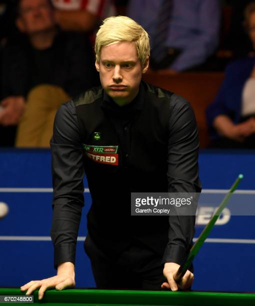 Neil Robertson lines up a shot against Noppon Saengkham during their first round match of the World Snooker Championship at Crucible Theatre on April...