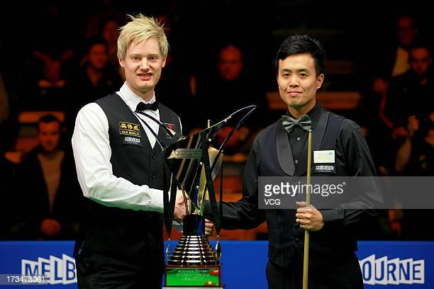 Neil Robertson of Australia and Marco Fu of Hong Kong shake hands after the final match of the World Snooker Australia Open at the Bendigo Stadium on...