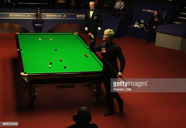 Neil Robertson of Australia blows a kiss to his mother Alison Hunter after beating Graeme Dott of Scotland during the final of the Betfredcom World...