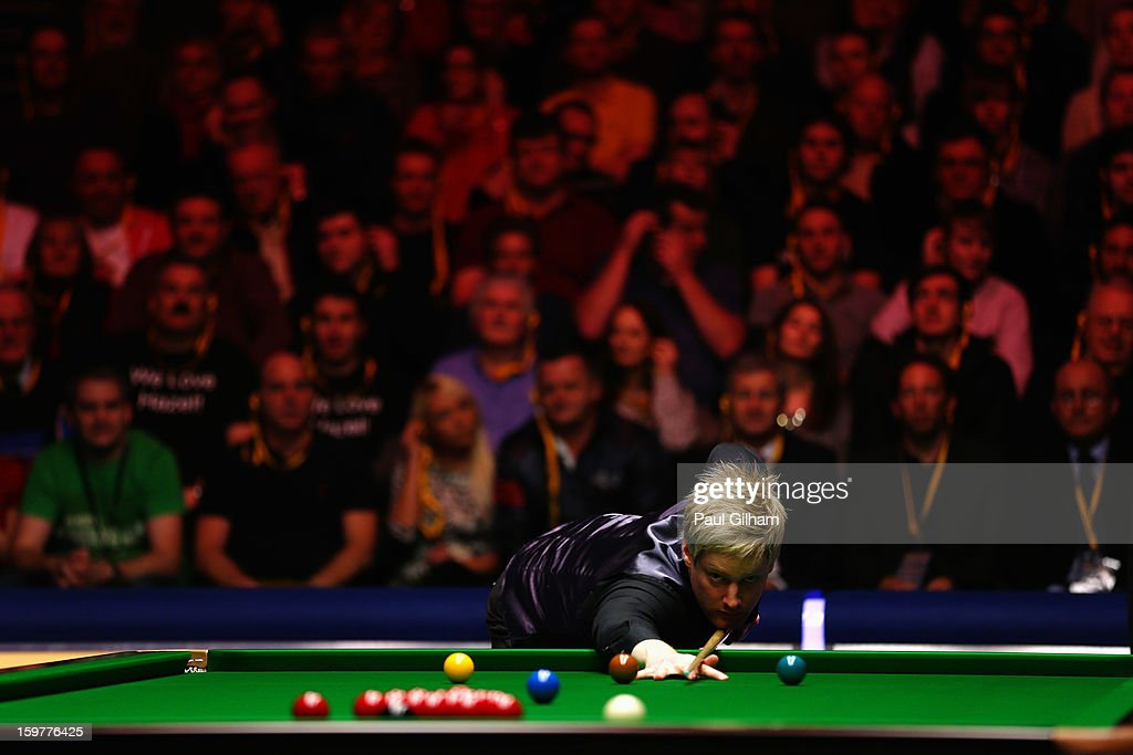 Neil Robertson of Australia breaks during The Masters Final between Mark Selby of England and Neil Robertson of Australia at Alexandra Palace on January 20, 2013 in London, England.
