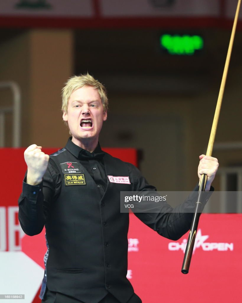 Neil Robertson of Australia celebrates after winning the final match against Mark Selby of England during day seven of the 2013 World Snooker China Open at Beijing University Students Gymnasium on March 31, 2013 in Beijing, China.