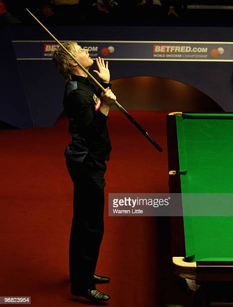 Neil Robertson of Australia celebrates beating Graeme Dott of Scotland to win the Betfredcom World Snooker Championships at The Crucible Theatre on...