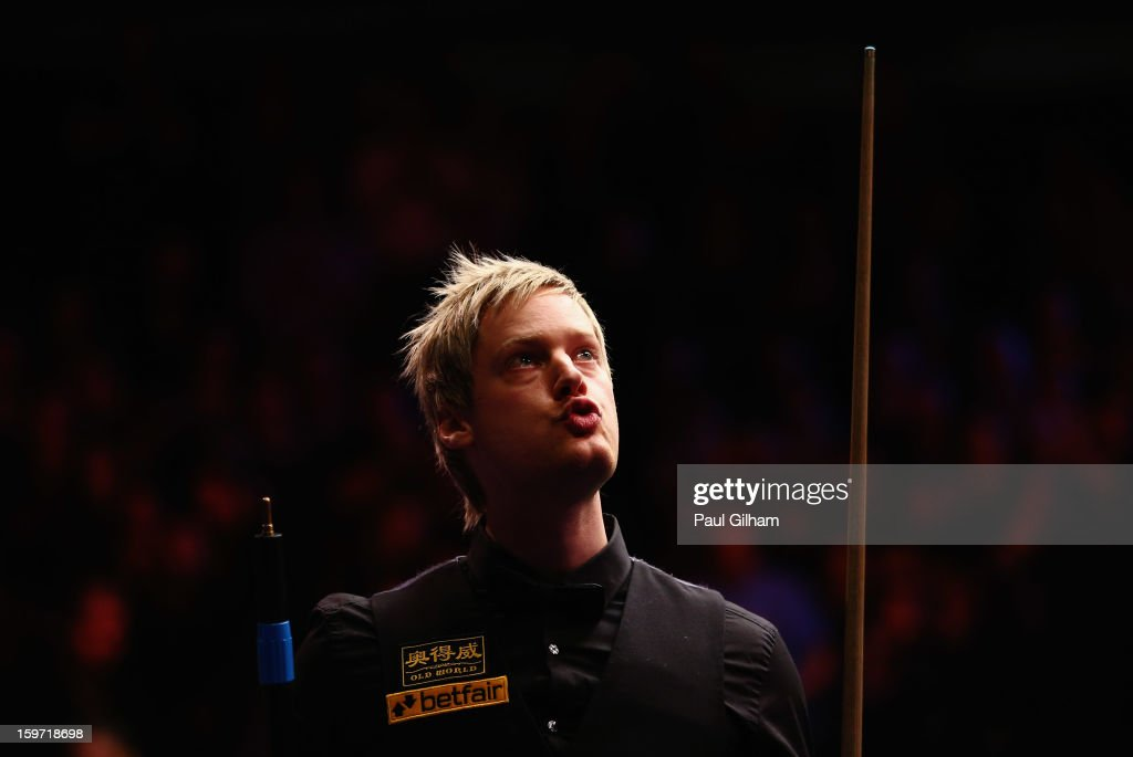 Neil Robertson of Australia celebrates making it into the final after a 6-2 victory in the semi-final match between Neil Robertson of Australia and Shaun Murphy of England at Alexandra Palace on January 19, 2013 in London, England.