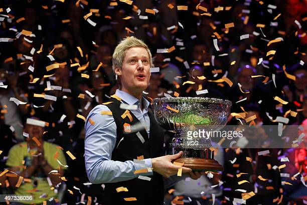 Neil Robertson of Australia celebrates with his trophy after final match against Mark Allen of Northern Ireland on day six of Champion of Champions...