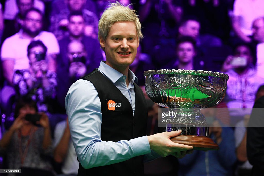 Neil Robertson of Australia celebrates with his trophy after final match against Mark Allen of Northern Ireland on day six of Champion of Champions 2015 at Ricoh Arena on November 15, 2015 in Coventry, United Kingdom.