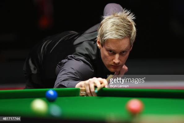 Neil Robertson of Australia in action against Shaun Murphy of Great Britain during the final of the Dafabet Masters at Alexandra Palace on January 18...