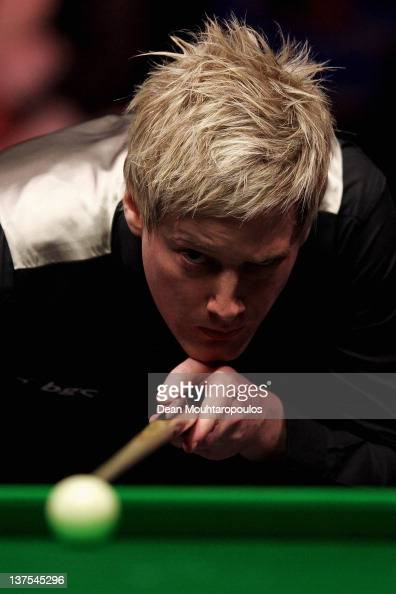 Neil Robertson of Australia lines up a shirt during his match against Shaun Murphy of England during The Final on day 8 of The Masters at Alexandra...