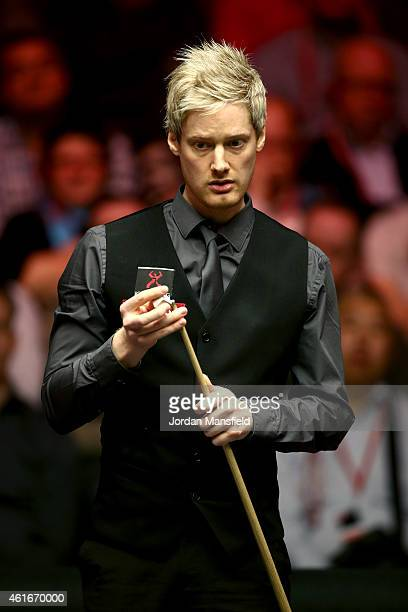 Neil Robertson of Australia lines up a shot during his semifinal match against Ronnie O'Sullivan of Great Britain on day seven of the 2015 Dafabet...