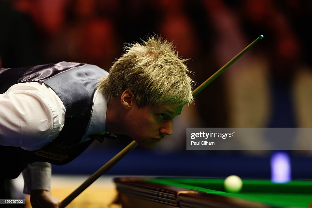 Neil Robertson of Australia lines up a shot during The Masters Final between Mark Selby of England and Neil Robertson of Australia at Alexandra Palace on January 20, 2013 in London, England.