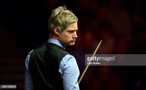 Neil Robertson of Australia looks on during his quarter final match against Judd Trump of England during Day Six of The Dafabet Masters at Alexandra...