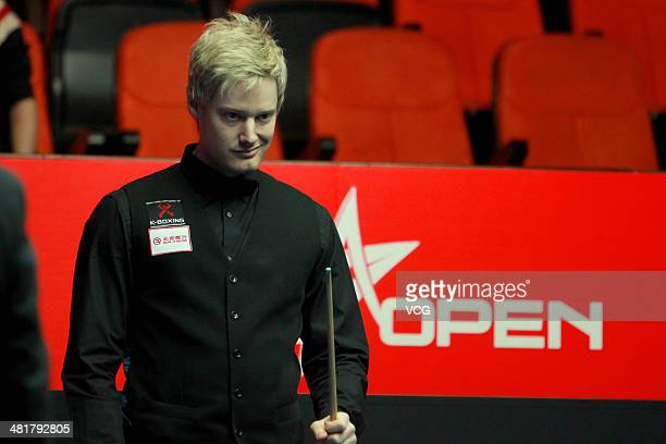 Neil Robertson of Australia looks on during the match against Anthony Hamilton of England on day one of the 2014 World Snooker China Open at Beijing...