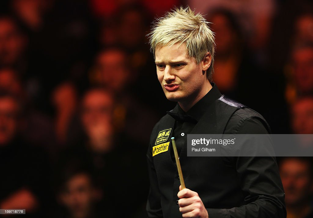 <a gi-track='captionPersonalityLinkClicked' href=/galleries/search?phrase=Neil+Robertson&family=editorial&specificpeople=668815 ng-click='$event.stopPropagation()'>Neil Robertson</a> of Australia looks on during the semi-final match between <a gi-track='captionPersonalityLinkClicked' href=/galleries/search?phrase=Neil+Robertson&family=editorial&specificpeople=668815 ng-click='$event.stopPropagation()'>Neil Robertson</a> of Australia and Shaun Murphy of England at Alexandra Palace on January 19, 2013 in London, England.